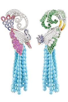 Van Cleef & Arpels  Oiseaux Amoureux earrings in white and pink gold; round, pear-shaped and baguette-cut diamonds; colored sapphire; emeralds; tsavorite garnets; and turquoise beads.