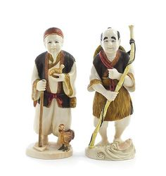 Description: Two Japanese Carved Ivory Figures, each with polychrome decoration, depicting a fisherman and a farmer, each signed to the underside.  Height 5 7/8 inches.