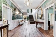 As soon as you enter you'll see a striking mural (a wallcovering that was printed in France) lining the hallway and all the way upstairs.
