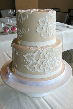 Ivory cake with white brush embroidered flowers.  Maybe the flowers could be in my colors, and keep the ivory cake.