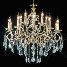 Torino Polished Gold Crystal.  The Torino is a beautiful polished gold chandelier, with a spiralling central body trimmed with crystal beads and suspended crystal droplets. Decorated with Asfour maple leaf crystal and drapes of small crystals.