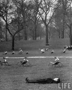 A man napping in Hyde Park . London, UK . February 1951 . Photo by Cornell Capa