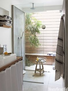 Throughout this small house there are huge windows that bring the outdoors in and make it seem larger, but I especially love this private deck right outside the master shower.