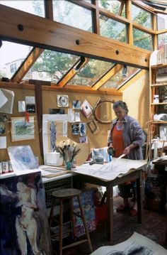 A nice light artist garden studio - we might be doing something similar to angled bit above work bench.