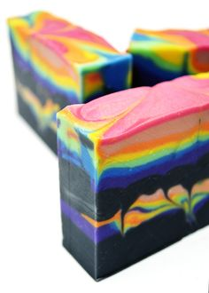"""It's time for anotherInspiration Soap Challengetutorial! Danafrom New England Handmade Artisan Soapsreceived one of the ISC kits, and madethis beautiful soapinspired by Bobby McFerrin's song """"Don't Worry, Be Happy"""" using at least four of the ingredients included in her kit. Danachallenged me: I would like to see you do a rainbow soap with red, orange,Don't stop there, keep reading!"""