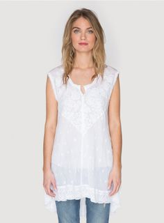 Ladera Tunic The Johnny Was LADERA TUNIC is a must-have! This boho tunic combines a tonal embroidery design and flared high/low hemline for a uniquely flattering fit. Pair the feminine LADERA TUNIC with jeans and a cardigan coat, or wear it over a silk slip dress in warmer weather!  - Rayon Georgette - Scoop Neckline, Four Button Henley Front Closure, Short Sleeves, High/Low Hemline - Signature Embroidery - Care Instructions: Machine Wash Cold, Tumble Dry Low