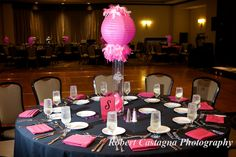 Pink and black Bat Mitzvah table centerpiece decor.