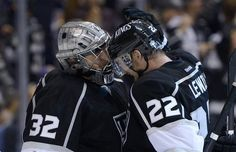 Los Angeles Kings goalie Jonathan Quick, left, is congratulated by center Trevor Lewis after they defeated the San Jose Sharks in Game 2 of their second-round NHL hockey Stanley Cup playoff series, Thursday, May 16, 2013, in Los Angeles. (AP Photo/Mark J. Terrill)