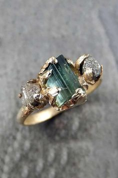 Raw diamonds and emerald set off this non-traditional engagement ring.