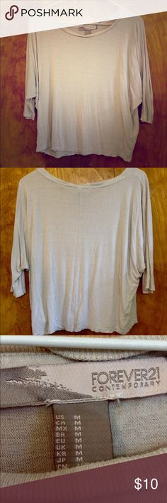 Forever 21 Slouchy Shirt This is a staple for the closet. This trendy item is perfect for days when you want to look cute and comfy. Forever 21 Tops Tees - Short Sleeve