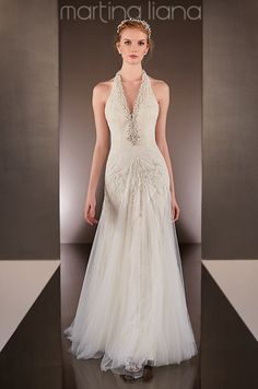 This sheath bridal gown features a V-neckline features elegant diamante beading on the halter. Martina Liana, Fall 2014