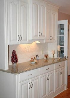 No fuss kitchen hutch! The subtle back splash and under lighting makes this piece pop!