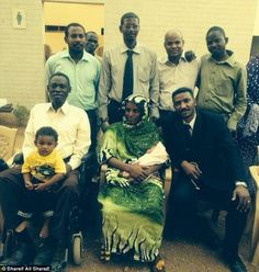 Safety fears: Rights groups are concerned for Meriam Ibrahim and her family, pictured after her release Monday, after they were arrested at an airport in Sudan by the feared National Intelligence and Security Services
