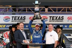 Jimmie Johnson Photos Photos - Jimmie Johnson, driver of the #48 Lowe's Chevrolet, celebrates with the trophy and Texas Motor Speedway President Eddie Gossage in Victory Lane after winning the NASCAR Sprint Cup Series AAA Texas 500 at Texas Motor Speedway on November 8, 2015 in Fort Worth, Texas. - NASCAR Sprint Cup Series AAA Texas 500 Press Conference