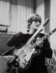 John Lennon during the recording sessions for Revolver, 1966