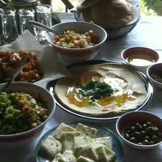 Arabic brunch:  Fried cubed potatoes , fried cauliflower, home made hummus, fired cheese, shepherd's salad, olives, oil and zatar, wheat pita, and tea with sage.