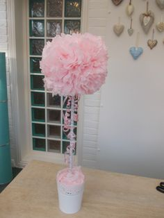 Pink tissue paper topiary tree . you can buy these from Sheila Betts Flowers.Alton.Hants. Great for parties or weddings. Other colours available.