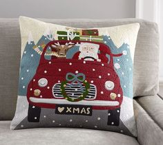 http://www.potterybarn.com/products/road-trip-santa-crewel-pillow-cover/?pkey=choliday-pillows