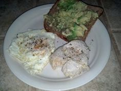 Breakfast – One egg cooked in Imagine Organic Free Range Chicken Broth (70), three oz Springer Mountain Farms chicken breast (100), one slice Ezekiel 7 Sprouted Grains bread (80), 1/4 avocado (75). Total calories 325.