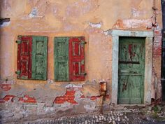 old wall with door and shutters