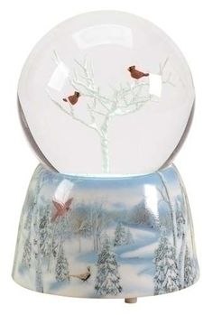 Snow Globe- how delightful are these red birds amongst the snowy white tree. Lovely!
