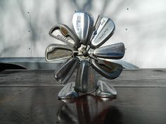 I know it's a clock, but it would make a great flower.  I just might have to make this for mom.