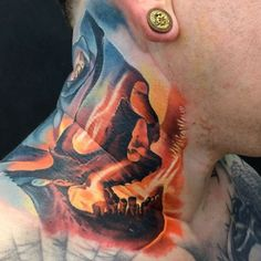 Colorful skull on neck by Levgen