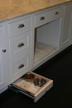 West End Cabinet Company. Pull out drawer for dog feeder. Thanks Suzie!