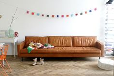 This leather sofa!!! | friday i'm in love with tommy by wood & wool stool, via Flickr