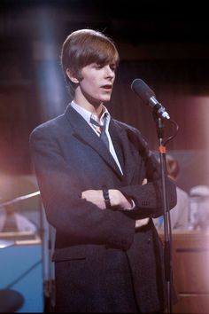 At Wembley Studios in London with his then-band, The Buzz, performing on a television show sporting a Mod look.