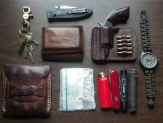 "Keys Benchmade Rift Stafford Executive Ostrich Wallet NAA .22 WMR Revolver in Homemade Pocket Holster Timex Expedition Field with Paracord Band Homemade ""You Never Know"" Bag with… 6' Paracord Coast G10 Flashlight Victorinox Tinker BIC Lighter Band-Aids Alcohol Wipes Needle and thread  Handyman in North Carolina  [[MORE]]"