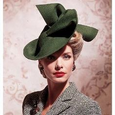 """1950s-While most hats remained close to the head, """"pancake"""" and """"cart-wheel"""" hats, wide-brimmed, flat pieces that perched atop short hairstyles were also popular."""