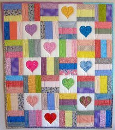 "Lovely Heart Baby Quilt  (This is just a couple of pictures and a description.  You can use the photo to easily make your own!)  This link has lots of ""How-To's"" and other great tips etc.  :)"
