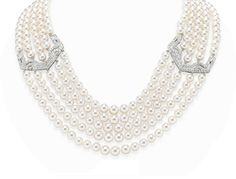 A CULTURED PEARL AND DIAMOND NECKLACE   Designed as five strands of graduated cultured pearls, measuring from approximately 6.40 to 7.90 mm, enhanced by two pierced old European and single-cut diamond geometric spacers, joined by an openwork diamond foliate clasp, mounted in platinum, 18 ins., (diamond spacers originally designed as hair combs, circa 1925)  Diamond spacers signed Cartier, Paris