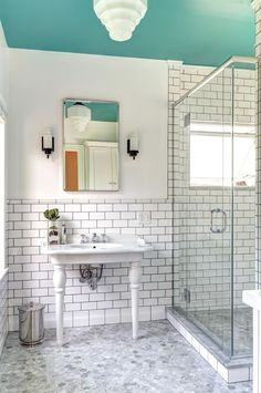 """The bathroom's painted ceiling brings a special magic to the room, proving that """"less is more"""" when a limited amount of color was added to the otherwise all-white décor. #housetrends http://www.davefox.com/"""