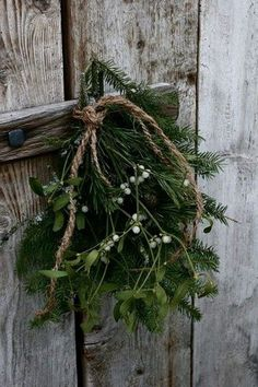 Tie misletoe together with twine to create a natural Christmas accent. Natural Christmas, Noel Christmas, Primitive Christmas, Little Christmas, Country Christmas, All Things Christmas, Winter Christmas, Christmas Wreaths, Christmas Decorations