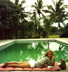 Socialite Alice Topping relaxing at a poolside in Palm Beach, 1959...