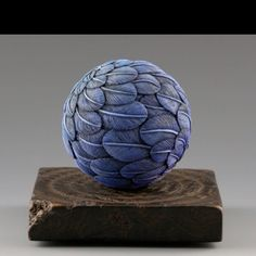 Oh neat idea!  I have TONS of left over clay ends waiting for inspiration.  Feather balls!  Be great ornaments.