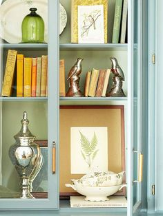 Vintage books and accessories make for a charming bookcase display. Tour the rest of this space: http://www.bhg.com/rooms/living-room/makeovers/eco-friendly-living-room-makeover/#page=1