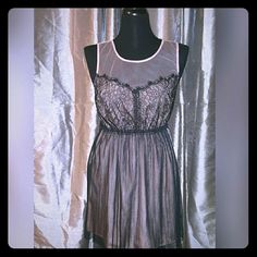 **Brand New** blush/nude and black mesh lace dress This is a super cute never worn dress that would be perfect for Homecoming, formal dance, prom, or wedding guests! The nude mesh is more on the blush color side, and is perfectly accented by the black lace and mesh. This dress is so adorable and would pair beautifully with nude, black, or gold heels. trades Dresses
