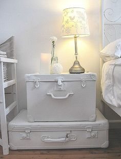 DIY old suitcases painted white and turned into a side table.