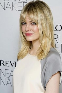 Emma Stone: Medium Length straight hair with bangs and layers Now I'm thinking, really thinking bout getting this hair cut! Oh my!!!   best stuff