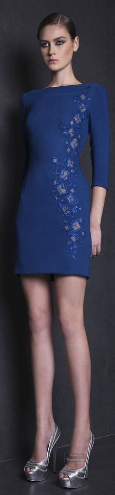 Tony Ward Spring-summer 2015. - The  embellishments in the left side of this dress, right from the top sleeve to the hem are completely amazing. It is all done in the same color as the dress with a tad of pink. The light navy blue color is interesting. the boat shaped neckline add a very modern feel to the dress. What could be more fitting than shining silver platform pumps. Picturesque !!!