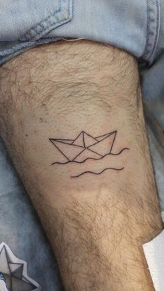 Simple origami boat tattoo