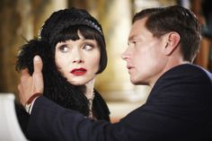 "Miss Fisher (Essie Davis) and Det. Inspector Jack Robinson (Nathan Page) share an intimate moment on the show ""Miss Fisher's Murder Mysteries."""