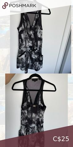 GUESS romper Black GUESS romper. Super comfortable and in mint condition. See through upper back panel. Guess Pants & Jumpsuits Jumpsuits & Rompers Denim Jumpsuit, Floral Jumpsuit, Striped Jumpsuit, Strapless Bustier, Ruffle Romper, Black Romper, Black Sweaters, American Apparel, Jumpsuits