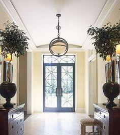 puerta doble hoja de hierro y vidrio