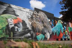 parrots on outside wall,graffiti by mantra rea