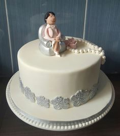 """70th Birthday cake - with pearls, roses and """"granny on coach"""" figurine"""