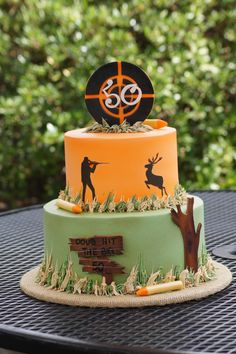 Tiered hunting themed birthday cake